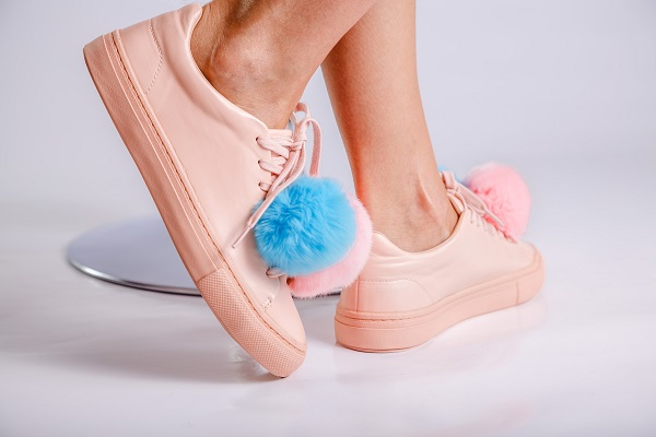 Pom pom decorated sneakers