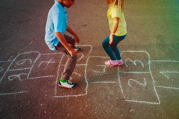 Kids playing on hopscotch